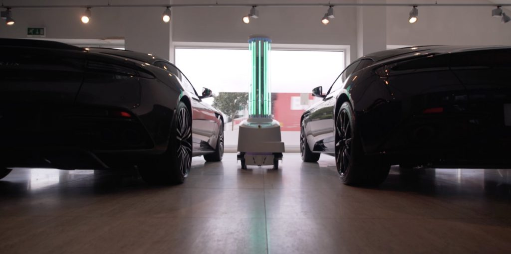 UVD Robot disinfecting between two cars at HWM Aston Martin showroom