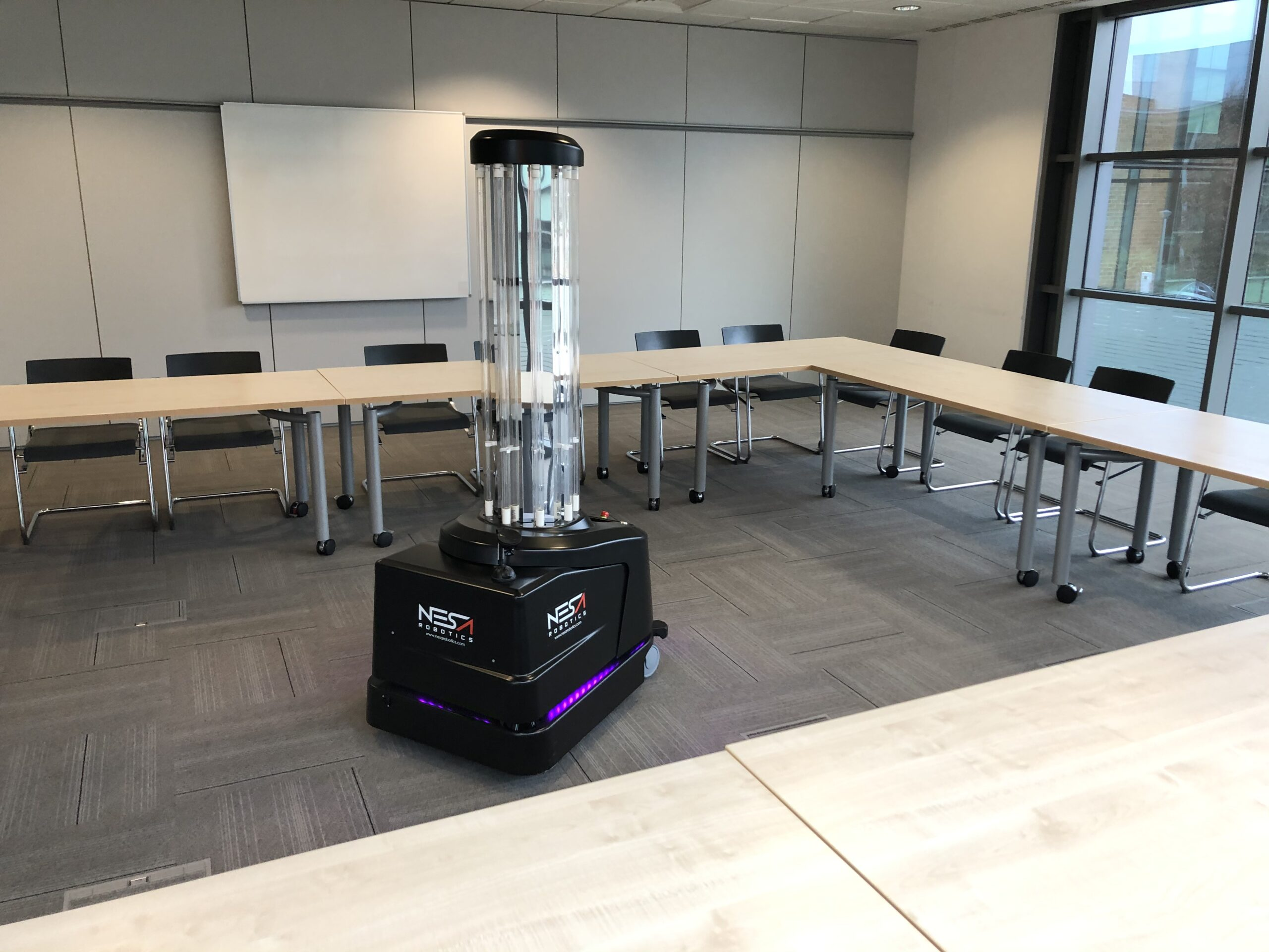 UVD Robot disinfecting a conference room at Siemens in front of their Facilities Management team